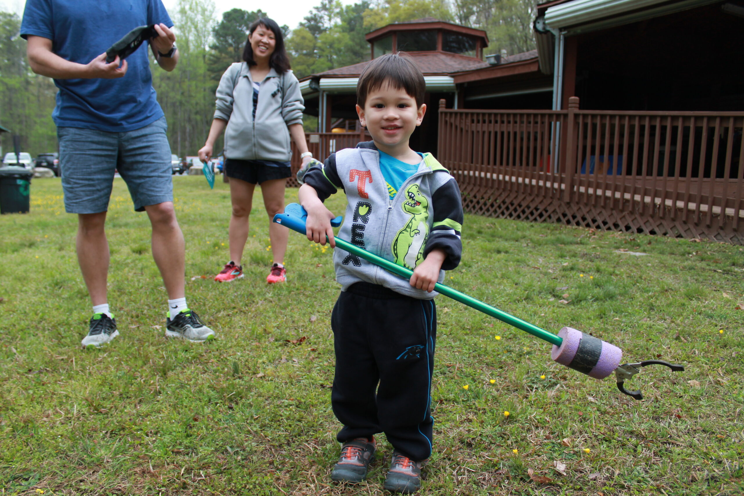 Young boy with trash grabber