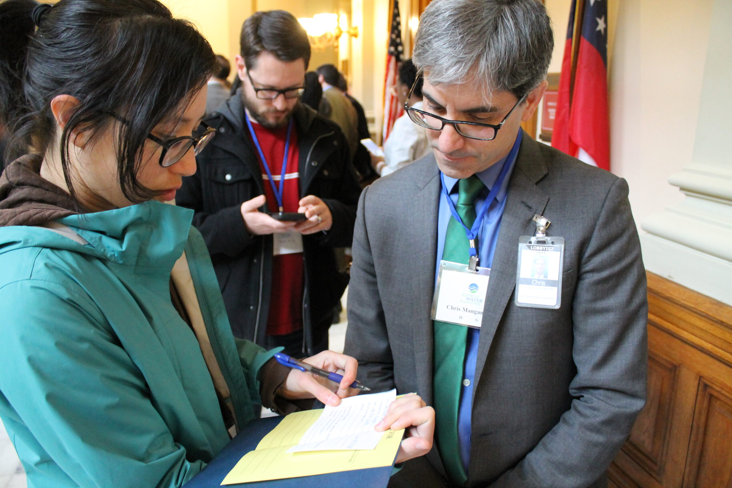 Man with woman look at paper in state building