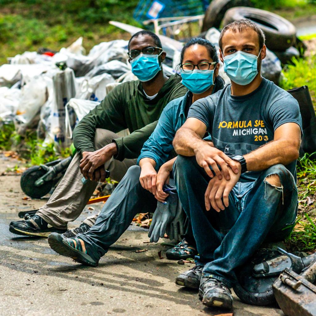 Trash cleanup volunteers wearing masks at Sweep the Hooch